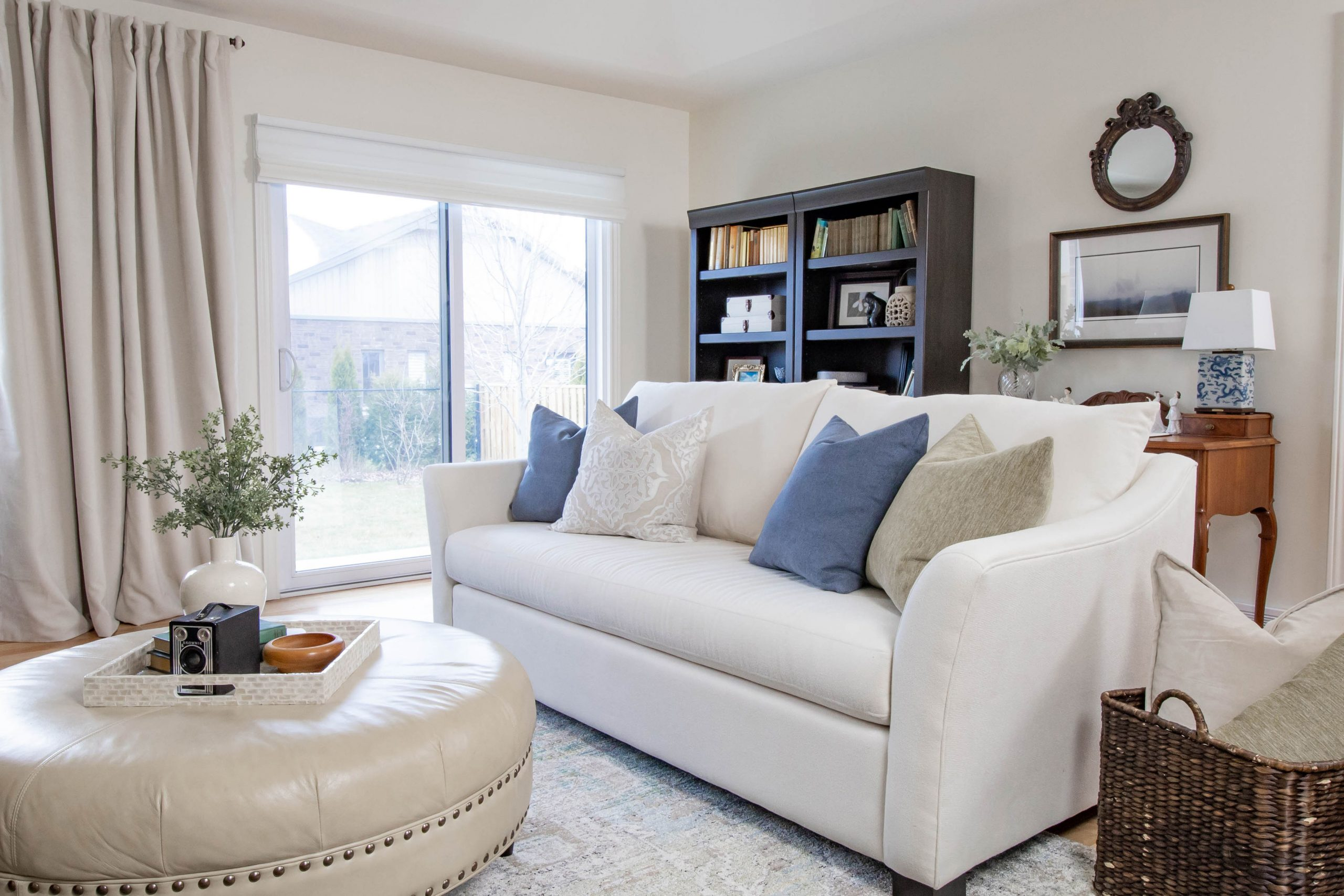 Light and airy modernized traditional design with european touches for this ivory living room in chatham