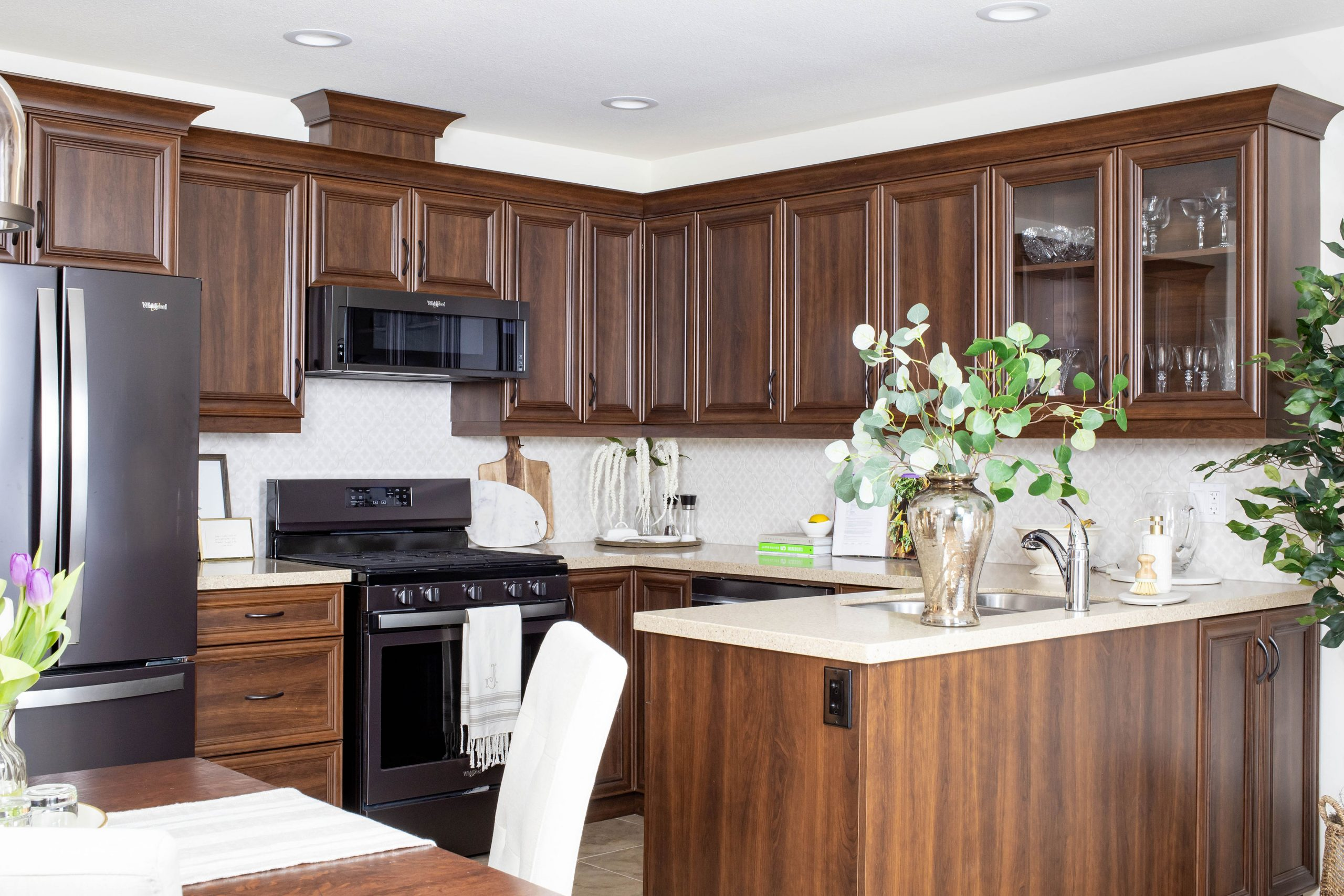 Interior designer transforms dark wood cabinetry to lighten up the kitchen