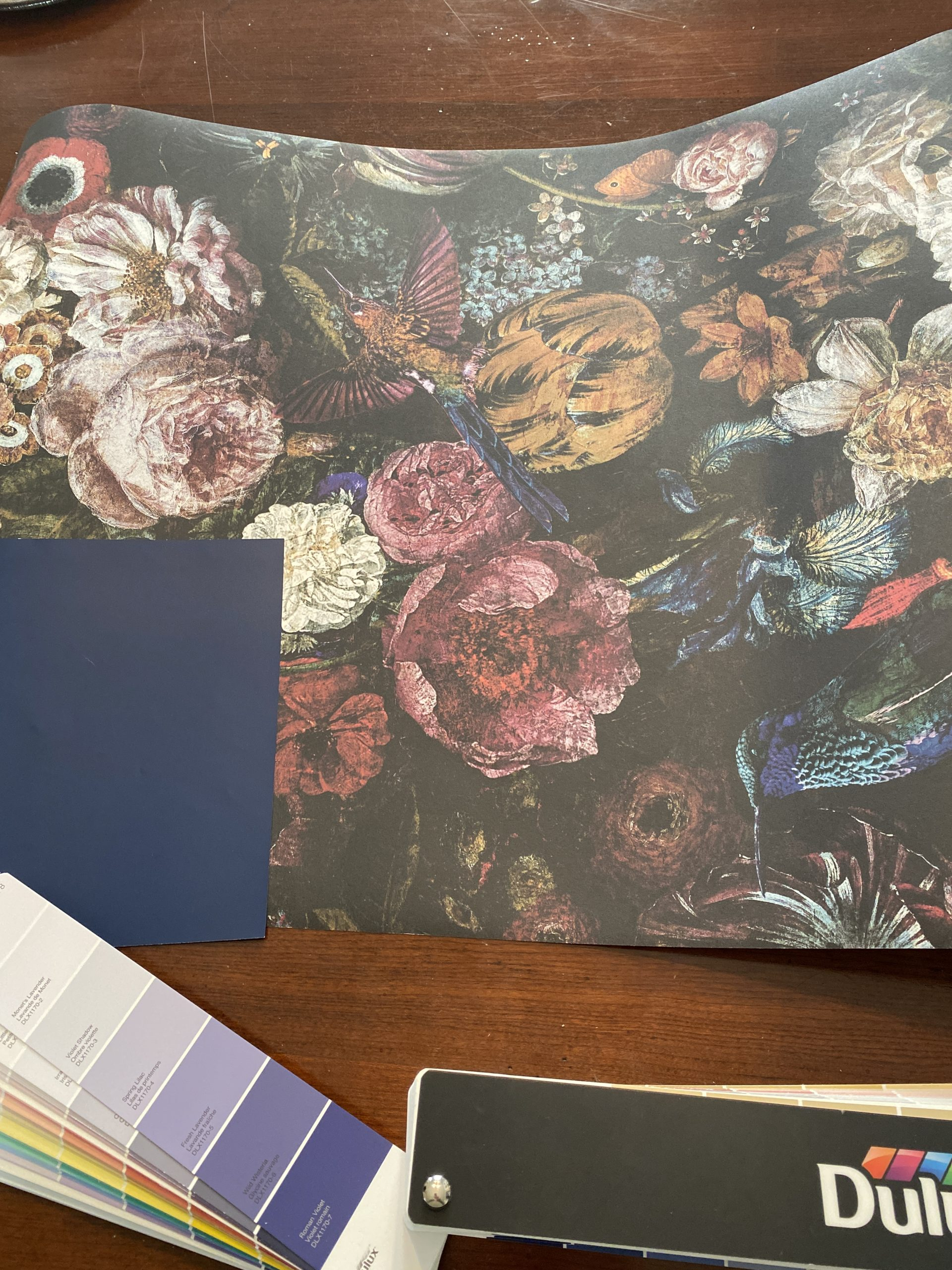 Interior designer in Windsor does flat lay to show wallpaper and paint options