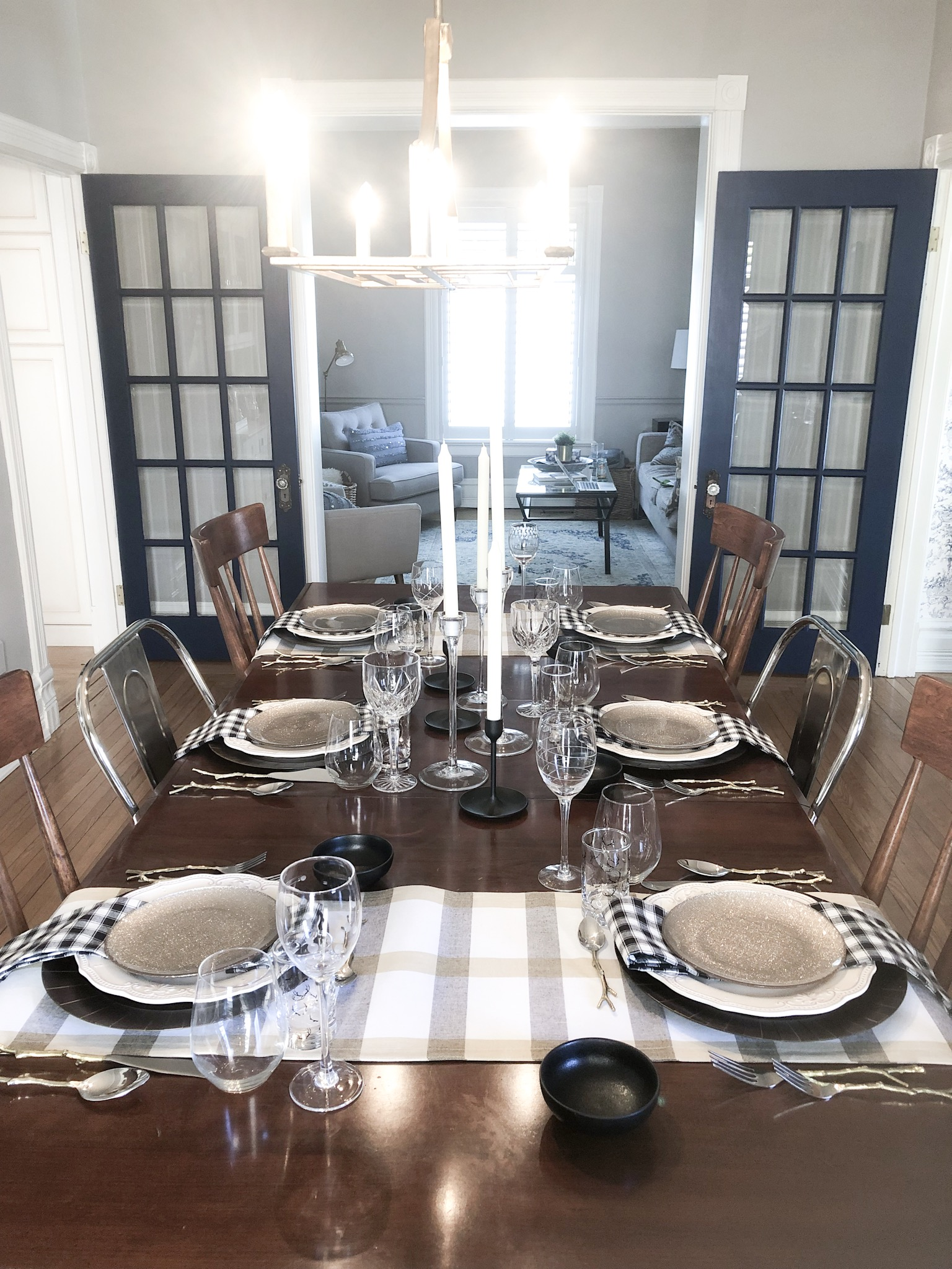 French doors in Dress Blues by Sherwin Williams are throughout the main floor of interior designer Heather Prestanski's living room