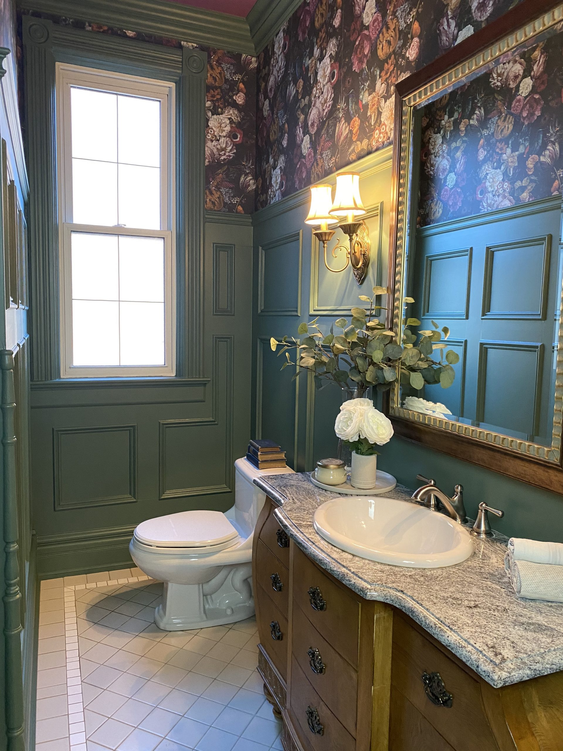 The Decorator played into the depth of the panel moulding for this stunning powder room design