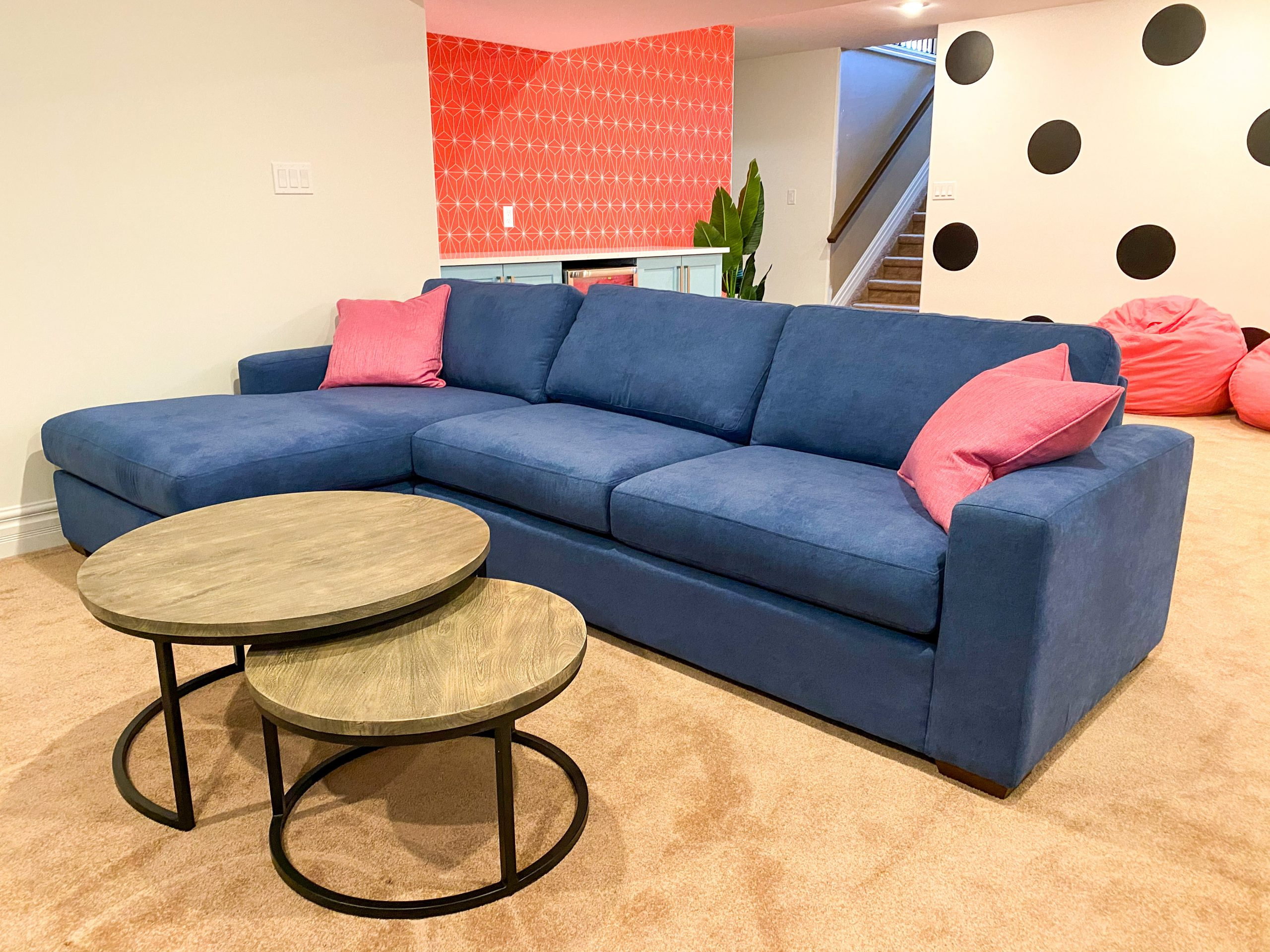 Colourful basement renovation in Lasalle Ontario including a blue sectional sofa