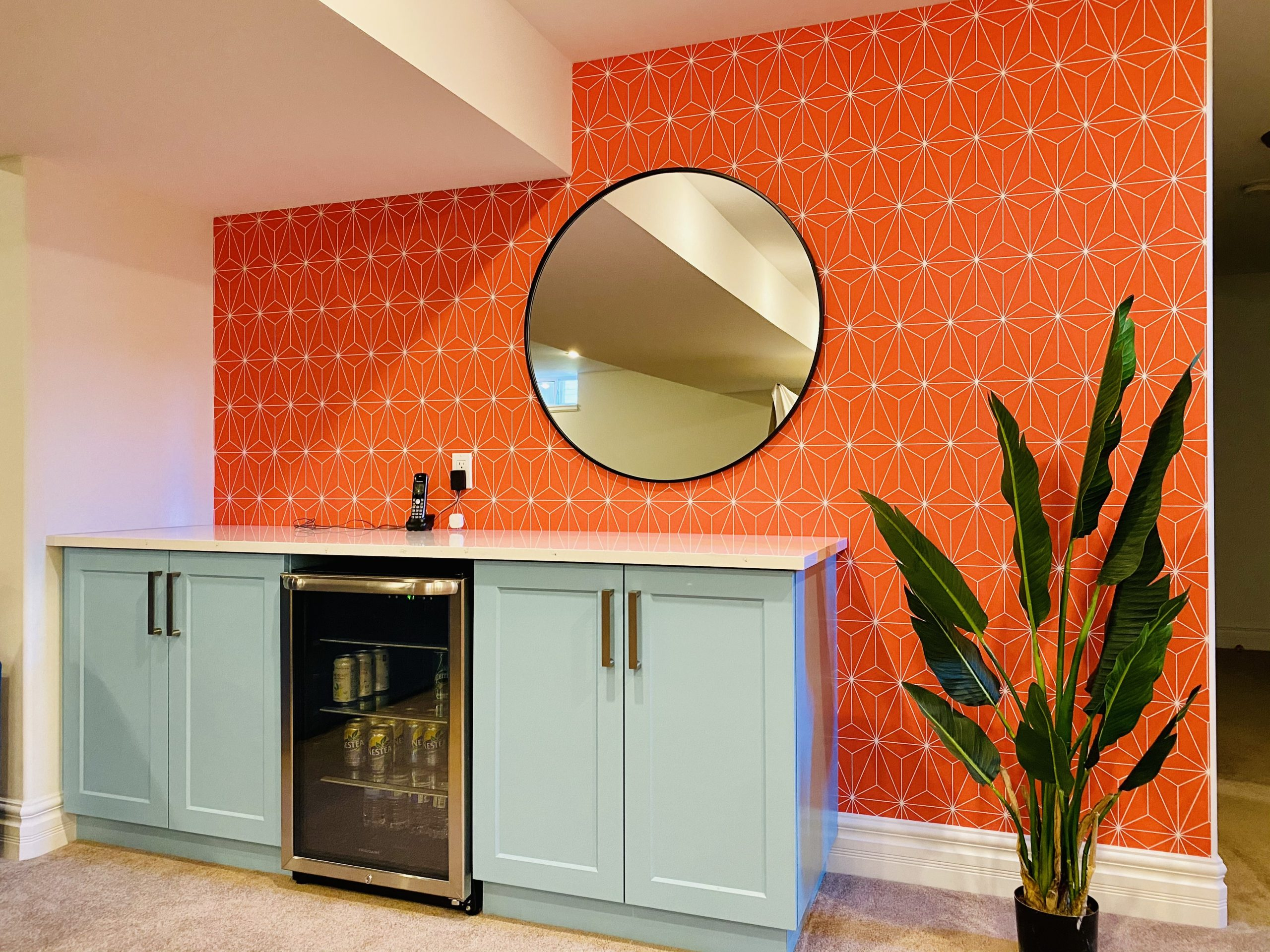 Interior designer in Windsor Ontario designs a colourful basement with custom cabinetry and wallpaper