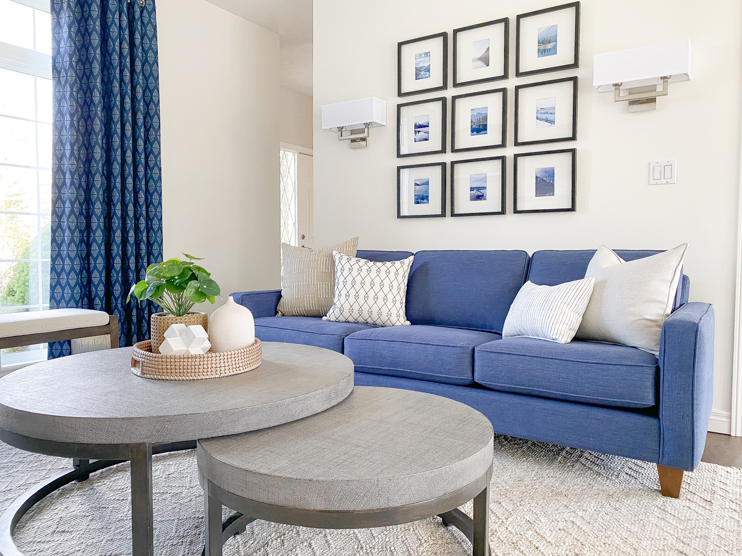 Blue sofa and gallery wall lakeside retreat transformation in Chatham Ontario