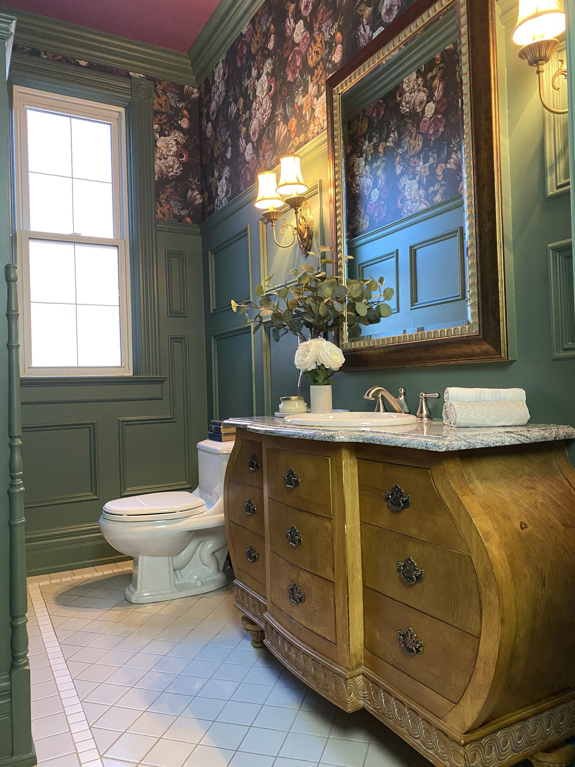 This green and floral powder room by Windsor based interior designer is a stunner